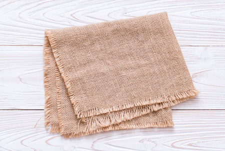 Photo pour kitchen cloth (napkin) on wood background with copy space - image libre de droit