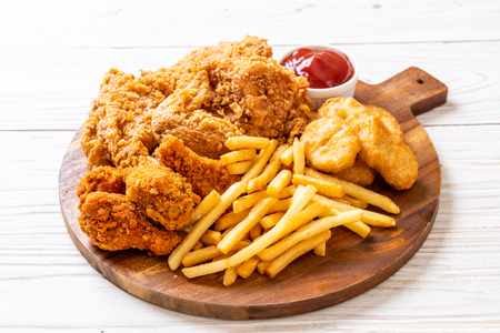 Photo for fried chicken with french fries and nuggets meal - junk food and unhealthy food - Royalty Free Image