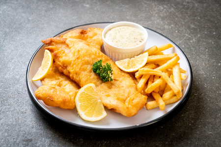 Foto de fish and chips with french fries - unhealthy food - Imagen libre de derechos