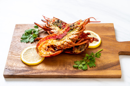 Foto de grilled lobster steak with lemon - Imagen libre de derechos