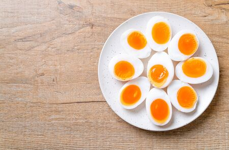 Foto per Soft Boiled Eggs on white plate - Immagine Royalty Free