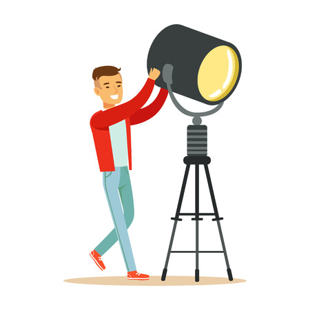 Illustration pour Electric or lamp man operator controlling lighting equipment. Film crew member. Cartoon male character concept. TV people at work. Vector illustration in flat style isolated on white background. - image libre de droit