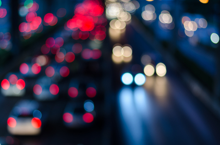 Foto de Blurry night light traffic in Bangkok city, Thailand. Abstract defocused background. - Imagen libre de derechos