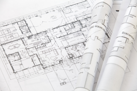Photo for Architect rolls and plans architectural plan  - Royalty Free Image