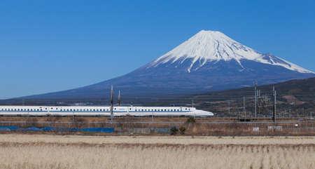 Bullet train Tokaido Shinkansen with view of mountain fuji at Shizuoka prefecture , Japan