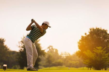 Photo pour Golfers are going to hit a golf ball. On the golf course during the summer - image libre de droit