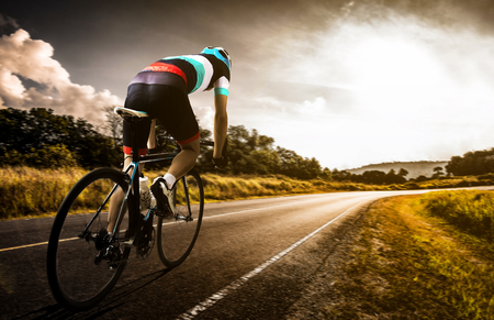 Photo pour  Men cycling road bike in the morning - image libre de droit
