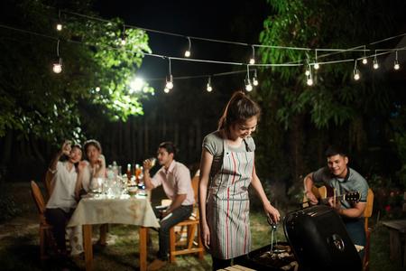 Photo pour People asians barbecue party In front garden - image libre de droit