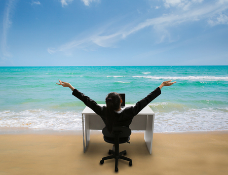 Photo for Employee are happy at work, she was reminded of her time to relax at the beach in the summer - Royalty Free Image