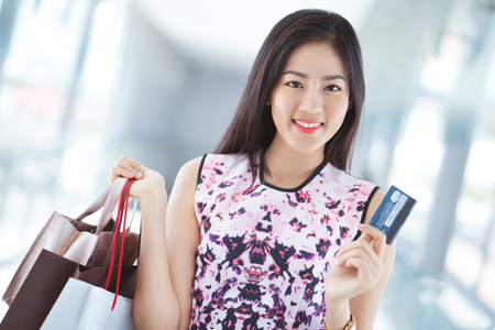 Foto für Asian woman using credit card for shopping in the mall - Lizenzfreies Bild