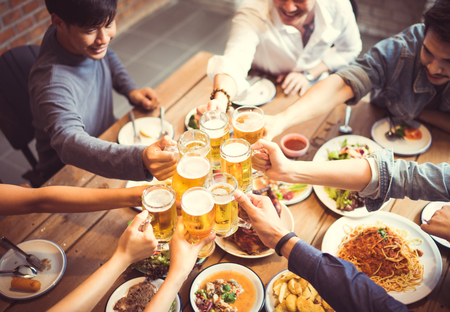 Foto de People in asian are celebrating the festival they clink glasses beer and dinner happy.top view - Imagen libre de derechos