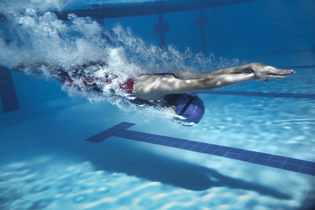 Photo for swimmer jump from platform jumping a swimming pool.Underwater photo - Royalty Free Image