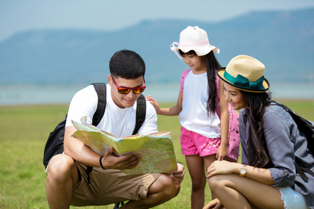 Photo pour Asian family planning a hiking adventure - image libre de droit