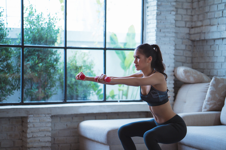 Photo for Asian women Exercise indoors she acted the squash - Royalty Free Image