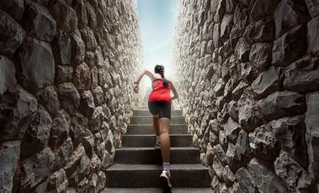 Foto de Women are exercising by running up the stairs. - Imagen libre de derechos