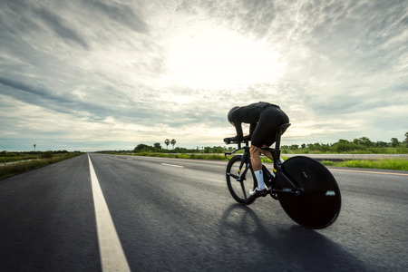 Photo for Asian men are cycling time trial bike in the morning - Royalty Free Image