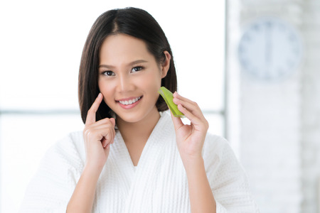 Photo for Asian women are using Aloe Vera on her face in the bathroom. - Royalty Free Image