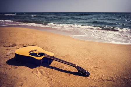 Foto de Guitar on the beach In the summer - Imagen libre de derechos