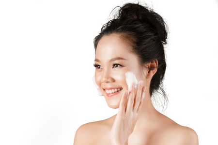 Photo for Asian woman use  facial foam to wash cosmetics off the face. - Royalty Free Image