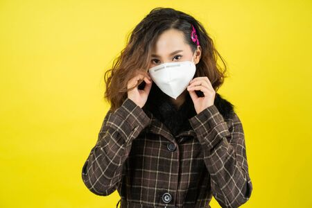 Photo for Asian woman she wears N95 mask.Prevent PM2.5 dust and smog studio concept - Royalty Free Image