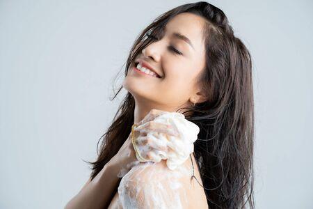 Foto de Asian woman  happy with the shower. Studio concept - Imagen libre de derechos