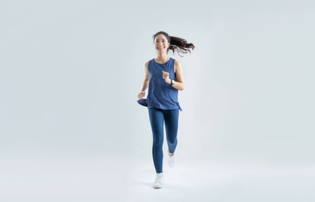 Foto de Asian woman run marathon studio white background. - Imagen libre de derechos