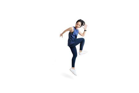Foto de Asian woman is jumping and exercising - Imagen libre de derechos