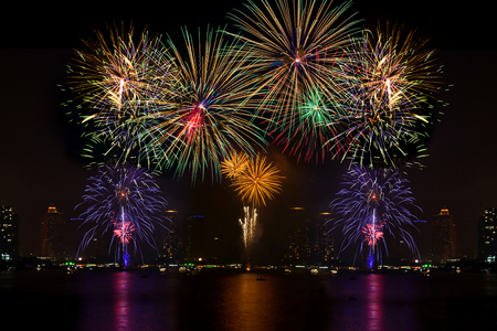 Foto de Beautiful firework display for celebration on the river - Imagen libre de derechos