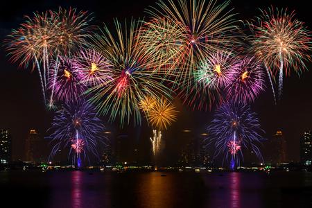 Photo pour Beautiful firework display for celebration with blur bokeh light background - image libre de droit