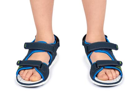 Photo pour Kids leather sandals on leg isolated on a white background. - image libre de droit