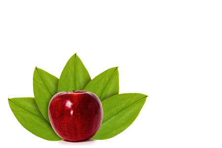 Foto de Fresh red apple on the background of green leaves. Isolated on white. concept of natural origin. Copy space - Imagen libre de derechos