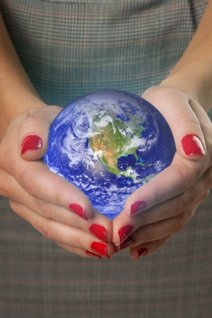 Women s hands holding the earth  Elements