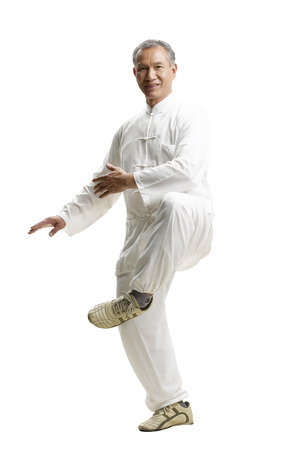 Photo for Portrait of senior man wearing Tai Chi clothes - Royalty Free Image