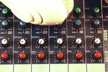 Photo for Volume control of the soundboard in the control room and voice recorder. - Royalty Free Image