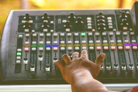 Photo for Technicians and professional audio equipment for the control of digital audio mixers. - Royalty Free Image