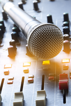 Photo for Analog microphone on the audio mixer. - Royalty Free Image