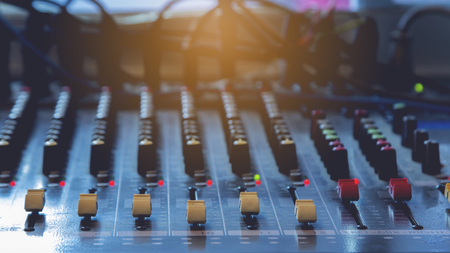 Photo for Slide the button to adjust the volume mixer of audio professionals. In the studio recording. - Royalty Free Image
