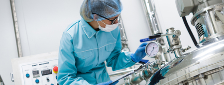 Photo for Scientists working with large vat in the lab, panoramic photo - Royalty Free Image