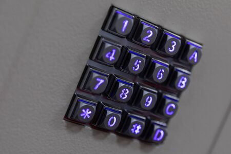 Photo for Black metal buttons with blue shiny lights numbers, including number sign hashtag and asterisk, A B C letters on gray abstract surface, diagonal view - Royalty Free Image