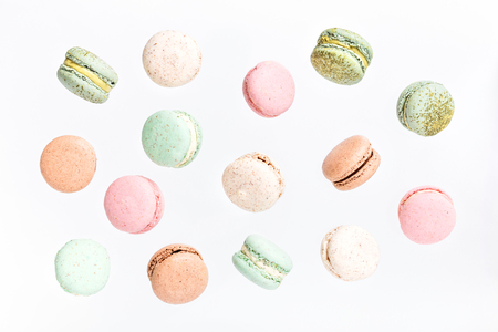 Photo pour Colorful macarons cake, top view flat lay, fly falling sweet macaroon on color white isolated background. Minimal concepts falling macaroons pattern above, food background - image libre de droit