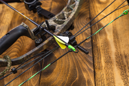 Photo for camouflage compound hunting bow with arrow - Royalty Free Image