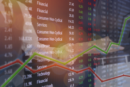 Foto de Hand shake business deal for exchange bitcoin and stock market concept for deal to be made. - Imagen libre de derechos