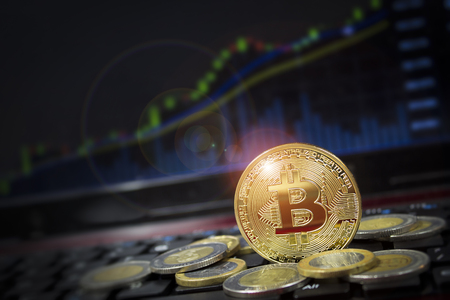 Photo pour Cryptocurrency bitcoin with US dollar competition with candle chart in background.  Copyspace for words. - image libre de droit