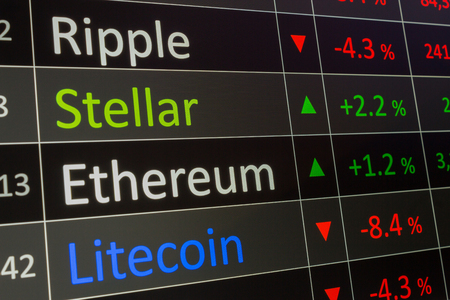 Foto de Stellar Coin crypto trading chart for buying and selling XLM.  Financial investments in cryptocurrency, and showing values on trading chart of exchange screen.  Closeup of business deal of buying and selling Stellar. - Imagen libre de derechos