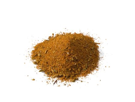 A close up on a pile of Cajun Seasoning isolated on a white background.
