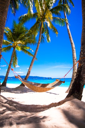 Photo for Straw hammock on tropical white sandy beach - Royalty Free Image