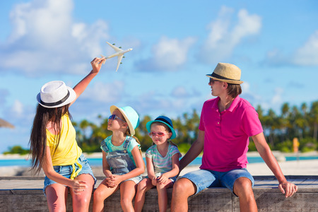 Photo for Family vacation. Airplane in woman hand. - Royalty Free Image