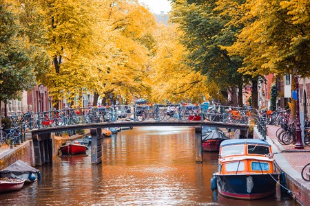 Photo pour Beautiful canal in autumn in the old city of Amsterdam, Netherlands, North Holland province. - image libre de droit