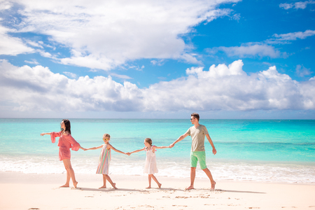 Photo pour Young family on vacation on the beach. Family travel concept - image libre de droit