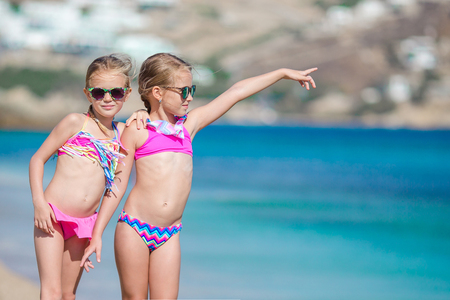 Photo for Two little girls together on the beach on vacation - Royalty Free Image
